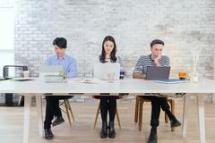 Multi-ethnic business people working in modern office Stock Photos
