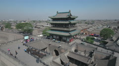Aerial drone shot flying away from tower reveals Pingyao ancient city in China Stock Footage
