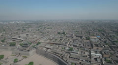 Aerial panoramic overview of the ancient walled city of Pingyao in China Stock Footage
