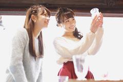 Young Japanese women enjoying visit to glass workshop in Kawagoe, Japan Stock Photos