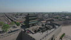 Panning aerial shot of traditional style pagoda building in Pingyao China Stock Footage