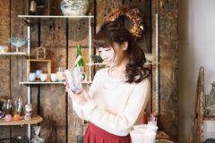 Young Japanese woman enjoying visit to glass workshop in Kawagoe, Japan Stock Photos