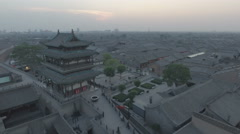 Flying over defense watchtower of Pingyao ancient city at sunset in China Stock Footage