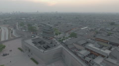 Flying over Pingyao ancient city at dusk Stock Footage