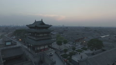 Drone flight away from entrance gate walled city Pingyao in China Stock Footage