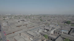 Flying backwards over hutongs and tradtional courtyard homes in Pingyao China Stock Footage