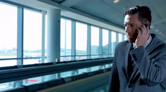 4K Happy Business Man Travel on Moving Walkway, Modern Traveller on Mobile Phone Stock Footage