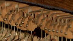 Music concept. Moving piano hammers, close-up Stock Footage