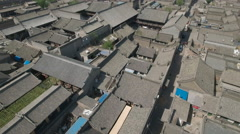 Drone shot over traditional courtyard buildings, hutong style homes China Stock Footage