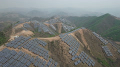Aerial flight massive solar panel power project in mountains Northern China Stock Footage