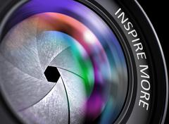 Inspire More Concept on Camera Photo Lens. 3D Stock Illustration