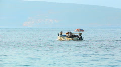 Fishermens drive the boat and go to the fishing at sea Stock Footage