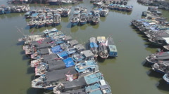 Aerial drone flight over old wooden fishing vessels in Sanya, South China Sea Stock Footage