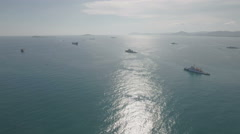 Aerial flight over Chinese coast guard vessels in South China Sea Stock Footage