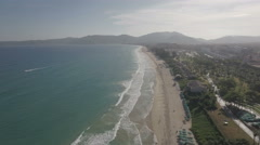 Aerial flight over beach on popular tropical Hainan island in China Stock Footage