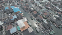 Aerial view of a local floating fishing community on Hainan island China Stock Footage
