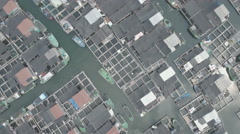 Overhead aerial shot floating fishing village, traditional lifestyle China Asia Stock Footage