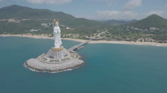 Tall white Buddha statue 'guarding over the South China Sea' Stock Footage
