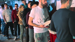 Students are waiting in a line for food in canteen Stock Footage