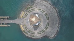 Vertical aerial shot of white Buddha statue on Hainan island, South China Sea Stock Footage