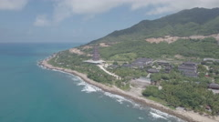 Flying towards large temple complex located along a beautiful coastline in China Stock Footage