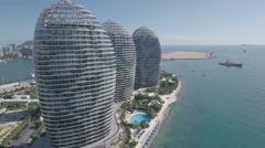 Aerial view of futuristic modern luxury hotel resort on tropical island China Stock Footage