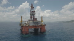Flying past a Chinese oil drilling platform rig in South China Sea Stock Footage