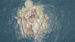 Overhead drone shot of Chinese oil rig in South China Sea Stock Footage