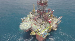 Aerial shot of Chinese offshore petrochemical oil rig installation Stock Footage