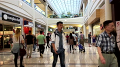 One side of people shopping inside Burnaby shopping mall Stock Footage
