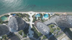 Aerial view looking down on the modern Phoenix hotel resort complex China Stock Footage