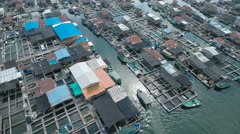 Aerial view of a local floating fishing community in Sanya, South China Sea Stock Footage