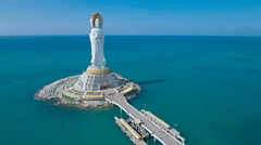 Aerial drone shot of massive Buddha statue in South China Sea Stock Footage