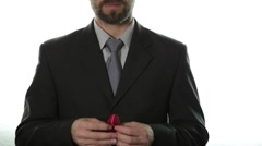 Close-up of man hands holding dark red disabled awareness ribbon. healthcare and Stock Footage