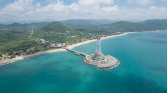 Aerial view of a tall white Buddha statue on Hainan island in China Stock Footage