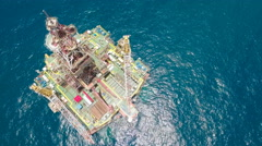 Petrochemical industry China, aerial view offshore oil platform Stock Footage