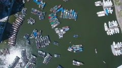 High angle overhead shot of old fishing fleet and luxurious yachts in China Stock Footage