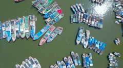 Overhead shot of fishing boats docked in the Sanya harbor in China Stock Footage