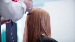 Blow-dry hair. Male hand hairdresser makes hair styling by hairdryer Stock Footage