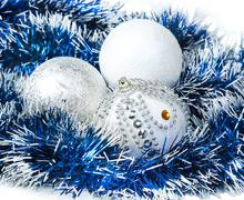 Christmas blue tinsel and white with silver glitter balls Stock Photos