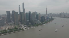 Aerial drone view of Pudong business financial district in Shanghai China Stock Footage