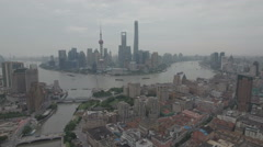 Aerial drone shot over the Bund and modern skyline Shanghai, China Stock Footage