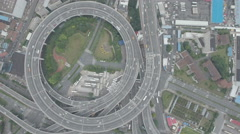 Top down aerial footage of Nanpu bridge spiral highway Shanghai, China Stock Footage