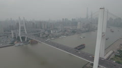 Locked aerial drone shot of the Nanpu bridge in Shanghai, infrastructure China Stock Footage