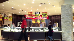 People shopping at Ben Moss jewellery store inside Coquitlam shopping mall Stock Footage