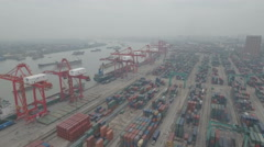 Aerial perspective container terminal of the Shanghai harbor in China Stock Footage
