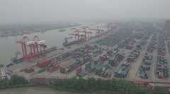 Aerial shot of container terminal Port of Shanghai, grey day with smog Stock Footage