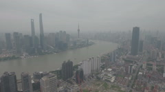 Aerial drone shot flying towards the Bund and Pudong in Shanghai Stock Footage