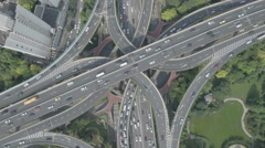 Top down view of traffic driving over busy intersection in Shanghai, China Stock Footage