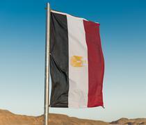 Egyptian flag on flagpole Stock Photos